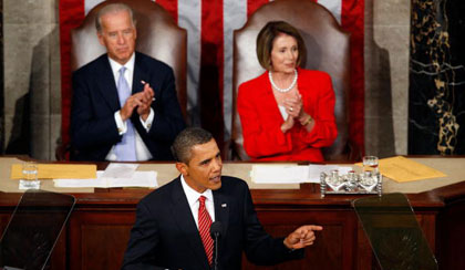 President Obama, with Vice President Biden and Speaker Pelosi behind him, delivers a joint address to Congress on September 9 (Alex Wong/Getty)